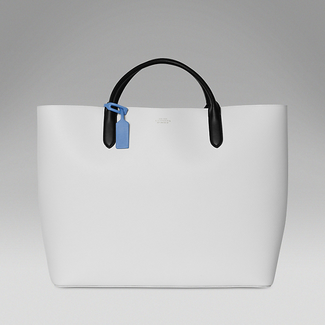 Smythson's Large Leather Tote, designed by artist Quentin Jones, is the ultimate summer bag.