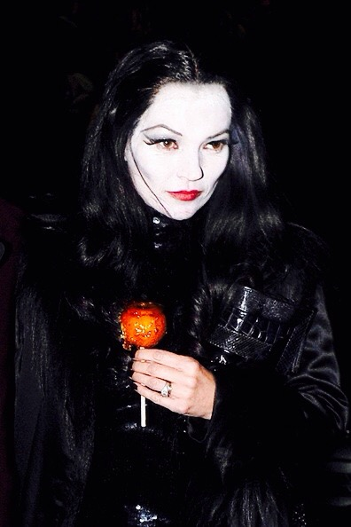 Kate Moss' modern Morticia is one of my all time favourites. False lashes, white paint and red lipstick; Kate makes it so easy to be chic.