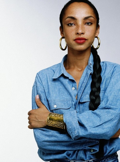 Sade's slick braided ponytail