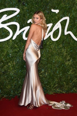 Karlie popped into this year's BFAs ahead of her second Victoria's Secret show in a silky champagne gown