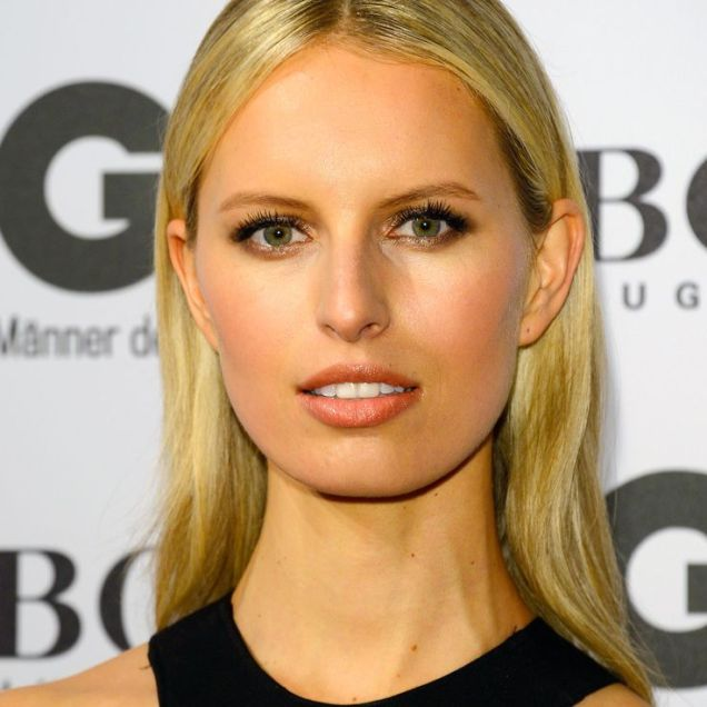Karolina Kurkova's poker straight, centre-parted hair tucked behind both ears is the epitome of effortless grown-up glamour