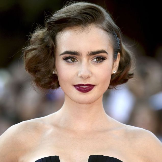 Lily Collins' faux bob is perfect for any balls you have coming up; curl under to an angle and side part.