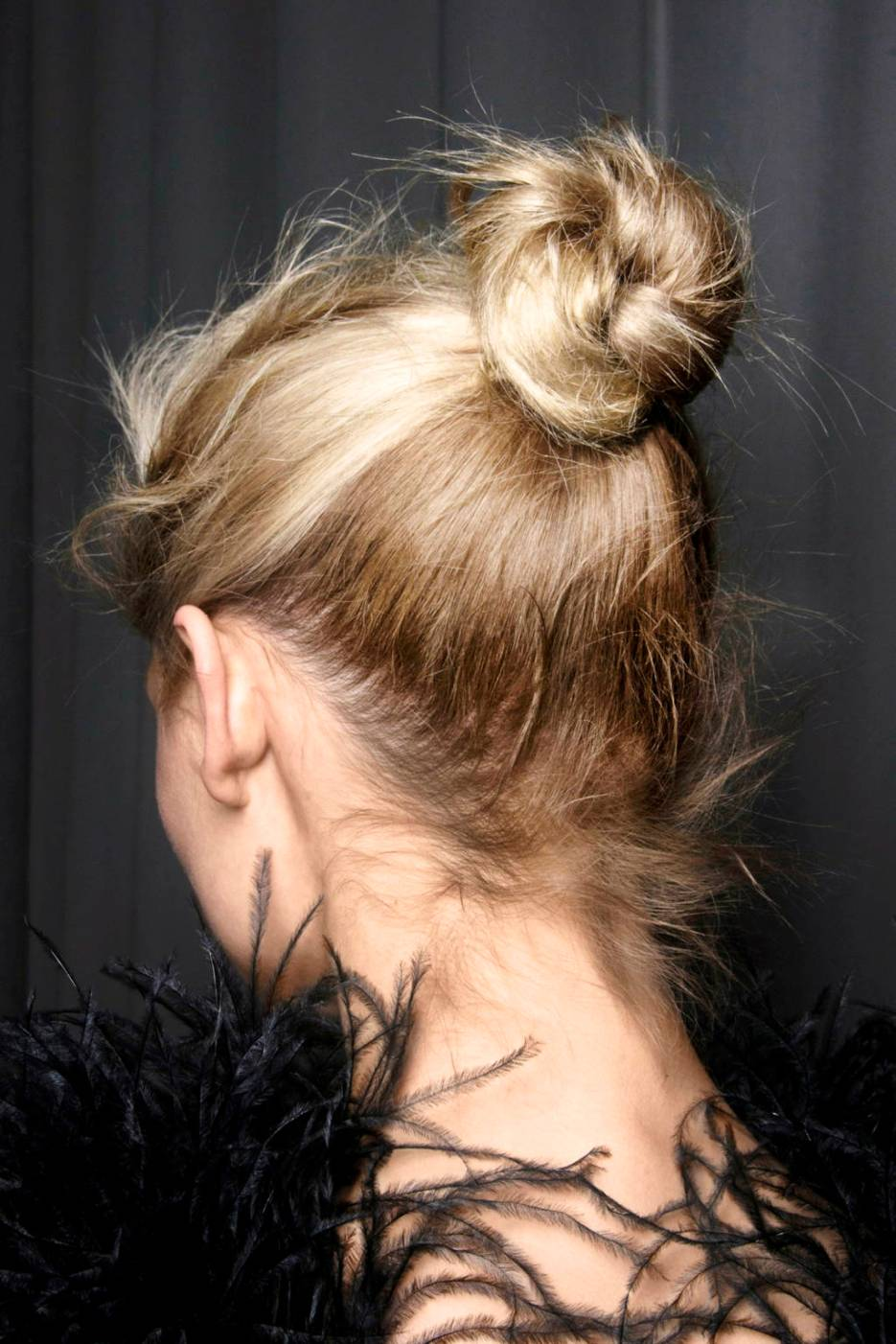 A messy top bun is easy and perfect for fur stoles and shift dress necklines