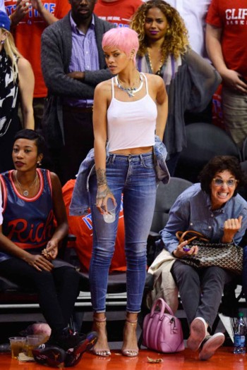 Rihanna seemed to watch a lot of basketball this year. We love her daring pink pixie cut