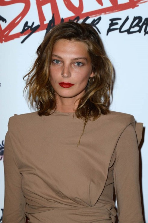 This is a pretty old picture of Daria, but her choppy lob and red lipstick couldn't be more now; and her bronzed complexion is showing us this look will last through summer.