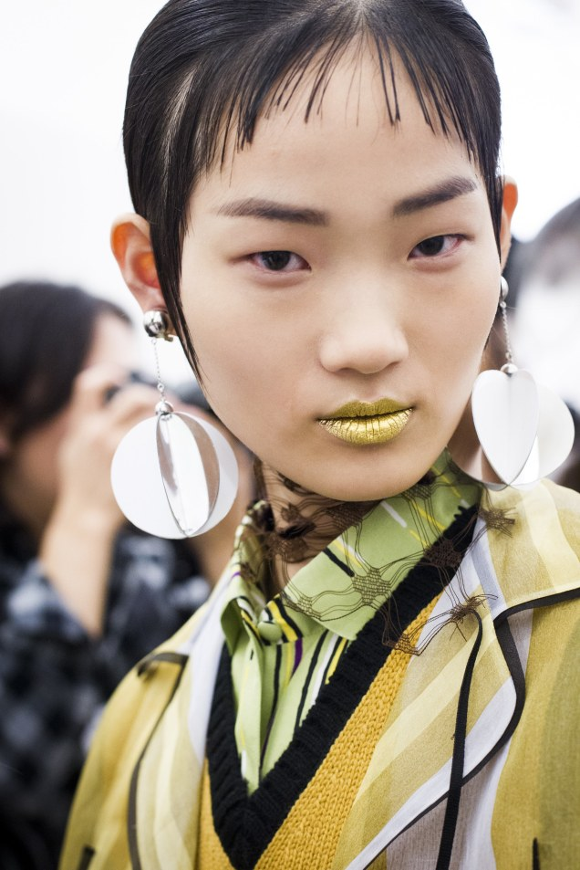 prada gold lips beauty backstage